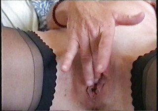 See my sexy mum fingering her pussy. Stolen video