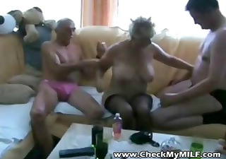 Old blonde amateur granny is in a threesome